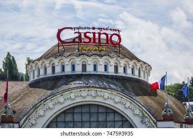EVIAN-LES-BAINS, FRANCE - JULY 23, 2017: View of old ornate facade of the historic Casino d'Evian. Evian-les-Bains on banks of Leman Lake, commune in Haute-Savoie department in Rhone-Alpes region.