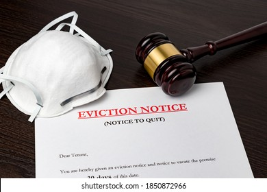 Eviction notice document with gavel and N95 face mask. Concept of financial hardship, housing crisis and mortgage payment default during Covid-19 coronavirus pandemic.