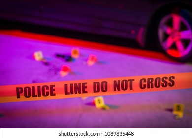 Evidence is marked with evidence markers within a crime scene. Cordon tape can be seen in the foreground.