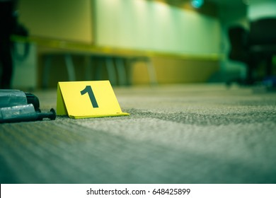 evidence marker number 1 on carpet floor with suspect object in crime scene investigation with copy space and cinematic tone