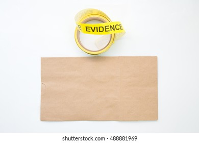 evidence marker tape and brown paper bag for crime scene  isolated with blank and copy space