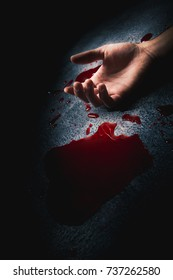 evidence markers on the floor with blood puddle /high contrast image