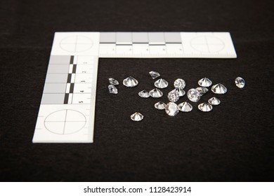 Evidence of smuggled 60 carats of diamonds documented by police authority with metric scale