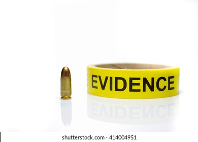 evidence tape with 9 mm bullet  on white background