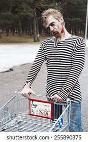 Evil bleeding zombie carring a shopping wagon