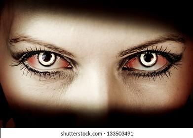 Evil bloody female zombie eyes. dirt  make up. Macro. Halloween theme
