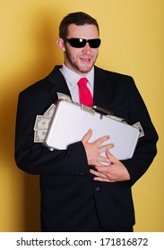 Evil business man hold suitcase with full of money notes