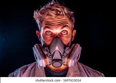 Evil and creepy science experiment concept, a scary scientist in gas mask respirator with yellow glowing demon eyes on a dark dusty enviroment wearing white doctor coat.