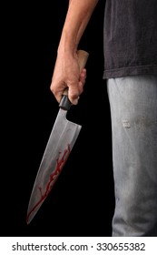 Evil criminal with large sharp knife ready for robbery or to commit a homicide isolated with clipping path inside