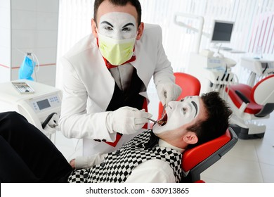 An evil dentist treats a tooth to a patient in a dental chair. Fear of the dentist.