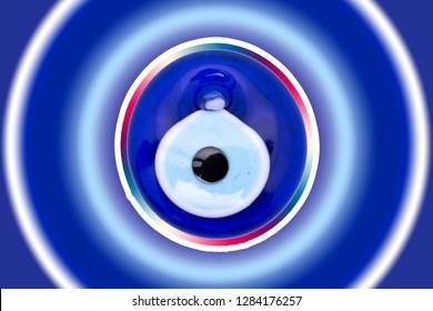 "Evil eye amulet on white background. Glass Turkish eye on white background with clipping path.Glass Turkish eye ""Nazar Boncugu"" on the white. colorful background"