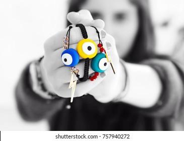 evil eye bracelets - greek jewelry advertisement - black and white photography