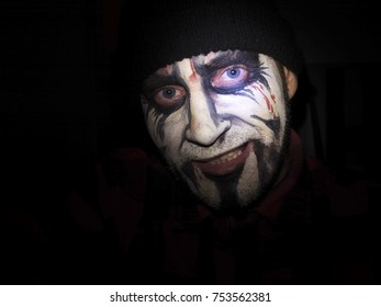 Evil face of a man with black metal mask - self-portrait