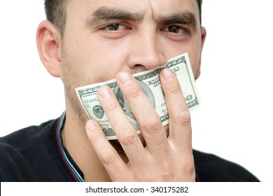 evil handsome young man mouth hundred dollar bills on a white background