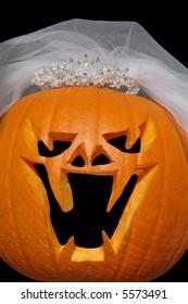 Evil jack-o-lantern bride with veil and tiara