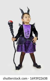 evil little girl witch in carnival halloween costume