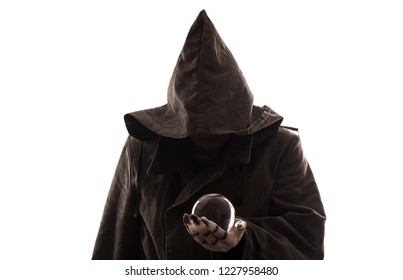evil magician with a glass ball,sorcerer