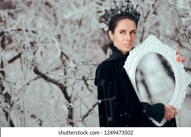 Evil Queen with Magic Mirror in Winter Wonderland. Vain Snow White Stepmother checking her beauty