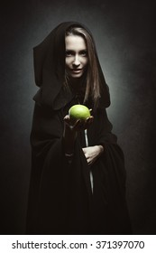 Evil queen offering a poisonous apple . Fairy tale and fantasy