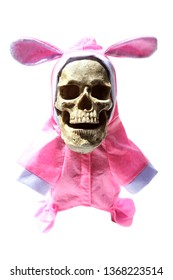 Evil Skull. Sinister Easter Bunny. Evil Skull wearing a pink Easter bunny hat. Halloween skull. Happy Easter. With dark shadows for a special evil effect. Text is easily removed and replaced.