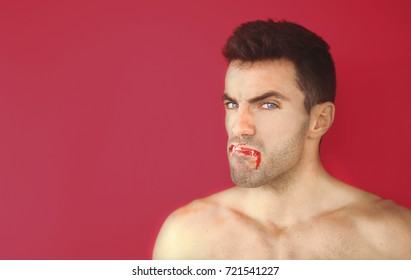 Evil vampire or dracula blood teeth with mad face on red background with copy space. Stock image