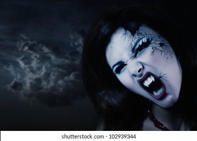 evil vampire woman beautiful halloween over night background