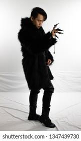 Evil warlock in black fur coat