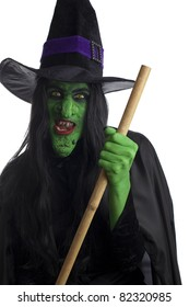Evil witch and her broom, white background.