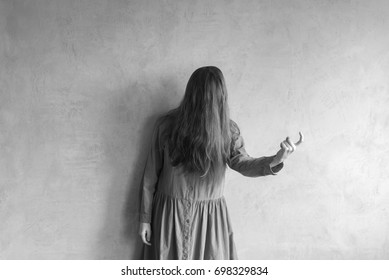 Evil woman beckoning someone