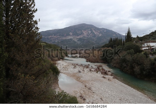 Evinos river and Rigani mountain from banias bridge near Nafpaktos,Greece