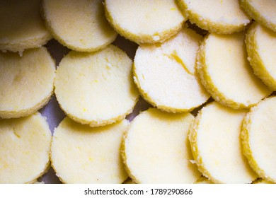 "evocative image of a typical Italian semolina and cheese recipe called ""Gnocchi alla romana (Roman dumplings)"""