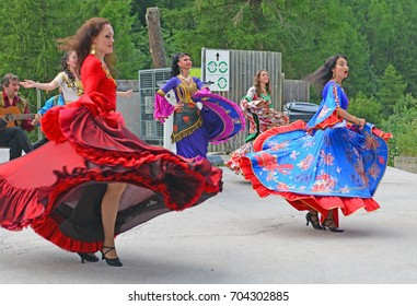 EVOLENE, SWITZERLAND - AUGUST 14: Russian dancers from the Ural mountains with gypsy dancers in traditional costumes:  August  14, 2017 in Evolene, Switzerland