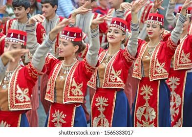 EVOLENE, SWITZERLAND - AUGUST 15: Armenian folk group in traditional costumes:  August  15, 2019 in Evolene, Switzerland