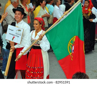 EVOLENE, SWITZERLAND - AUGUST 15: portuguese dance group at the International Festival of Folklore and Dance from the mountains (CIME) : August 15, 2011 in Evolene Switzerland