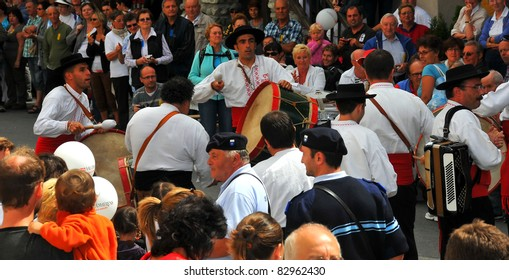 EVOLENE, SWITZERLAND - AUGUST 15: Portuguese drummers at the International Festival of Folklore and Dance from the mountains (CIME) : August 15, 2011 in Evolene Switzerland