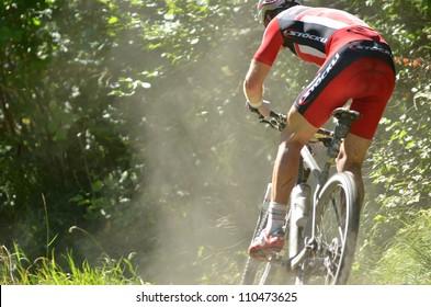 EVOLENE, SWITZERLAND  AUGUST 18:  Second placed Urs Huber taking a fast turn in the world famous Grand Raid mountain bike race:  August 18, 2012 in Evolene Switzerland