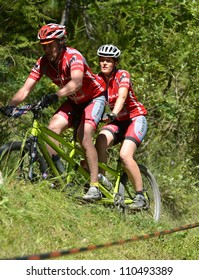 EVOLENE, SWITZERLAND  AUGUST 18:  Tandem champions Patrick Tabourat in the world famous Grand Raid mountain bike race:  August 18, 2012 in Evolene Switzerland