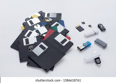 The evolution of digital data storage device. Floppy disks, flash drives and memory cards isolated on white background.