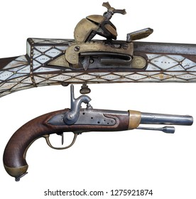 Evolution of Firearms. Antique flintlock rifle and percussion pistols.
