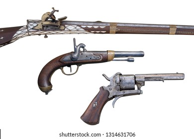 The Evolution of Firearms. Antique flintlock rifle, percussion pistols and revolver.