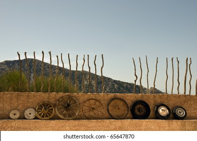 The evolution of the wheel starting from a stone wheel and ending with a steel belted radial tire.