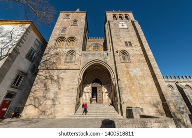 EVORA, PORTUGAL - CIRCA MARCH 2019: Main Facade of the Cathedral Dated in the XII Century Dedicated to the Virgin Mary in Evora.