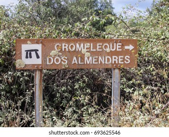 """Evora, Portugal - Circa September 2013: Rusted decaying sign of """"Cromeleque dos Almendres"""" (Cromlech of the Almendres) - megalithic complex and nationl monument in Portugal"""