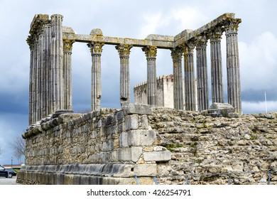 Evora, Portugal. The iconic Roman Temple dedicated to the Emperor cult, wrongly considered as a Goddess Diana Temple, with the Loios Convent used as a Historical Hotel. UNESCO World Heritage Site.