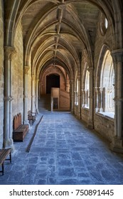 EVORA, PORTUGAL - JULY 01, 2016:  The interior of medieval cloister of Evora Cathedral (Se) with the massive arcade made of granite. Portugal