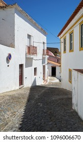 EVORA, PORTUGAL - JULY 1, 2016: The cozy narrow paved streets with white Alentejo country-style houses inside the old city walls of Mertola. Baixo Alentejo. Portugal