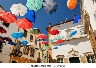 Evora. Portugal. Square full of colorful umbrellas.