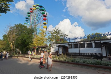 Evpatoria, Crimea, Russia - July 2, 2018: Ferris wheel and cafe Korean Courtyard in Frunze Park in the resort town of Evpatoria, Crimea