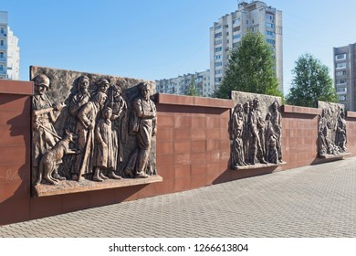 Evpatoria, Crimea, Russia - July 3, 2018: Wall with bronze bas-reliefs depicting the tragic events of wartime at the Red Hill memorial complex in the city of Evpatoria, Crimea