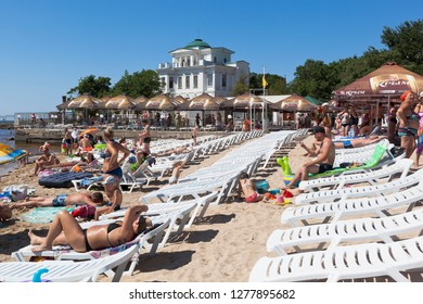 Evpatoria, Crimea, Russia - July 3, 2018: Rows of lounge chairs on the central city beach in the resort town of Evpatoria, Crimea